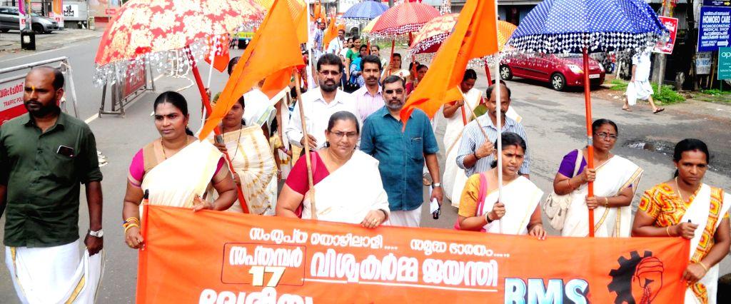 Bhartiya Mazdoor Sangh (BMS) activists carry out a rally during Viswakarma Jayanthi celebrations in Kannur, Kerela on Sept 17, 2017.