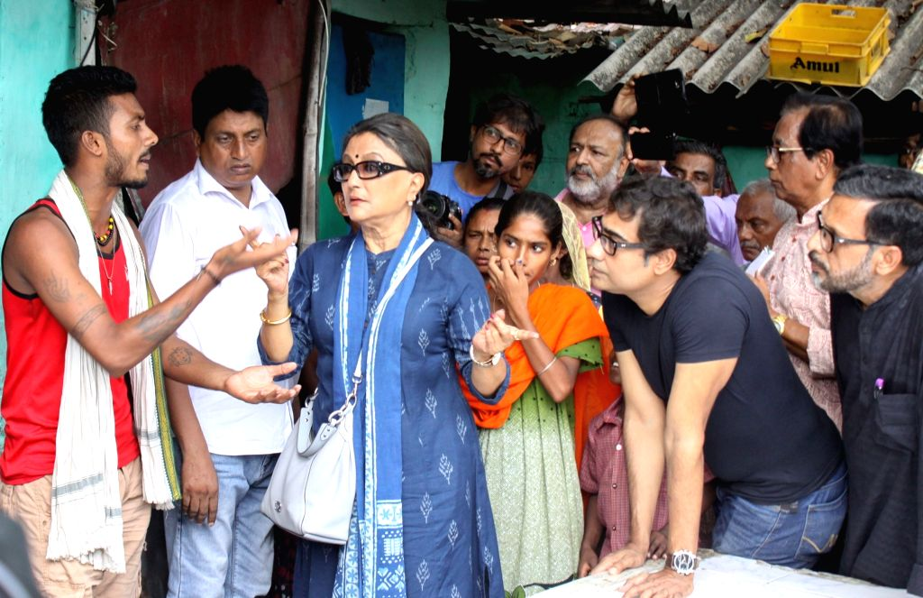 Bhatpara: A team of intellectuals led by actress-filmmaker Aparna Sen, actor Kaushik Sen and theatre artist Chandan Sen interact with a family member of Rambabu Shaw, who was shot dead during a clash in violence-hit Bhatpara in West Bengal's North 24 - Kaushik Sen and Indrajit Roy