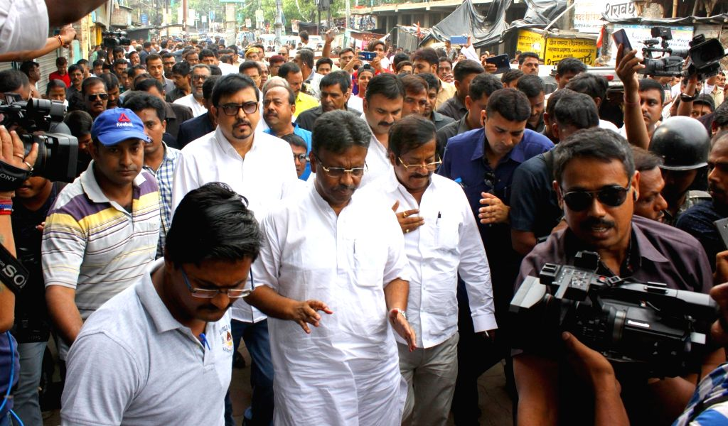 Bhatpara: A Trinamool Legislature Party delegation led by Fire Minister Sujit Bose, Urban Development Minister Firhad Hakim and Food Minister Jyotipriyo Mullick during their visit to the violence-hit Bhatpara in West Bengal on June 28, 2019. The eigh - Sujit Bose, Bratya Basu and Nirmal Ghosh