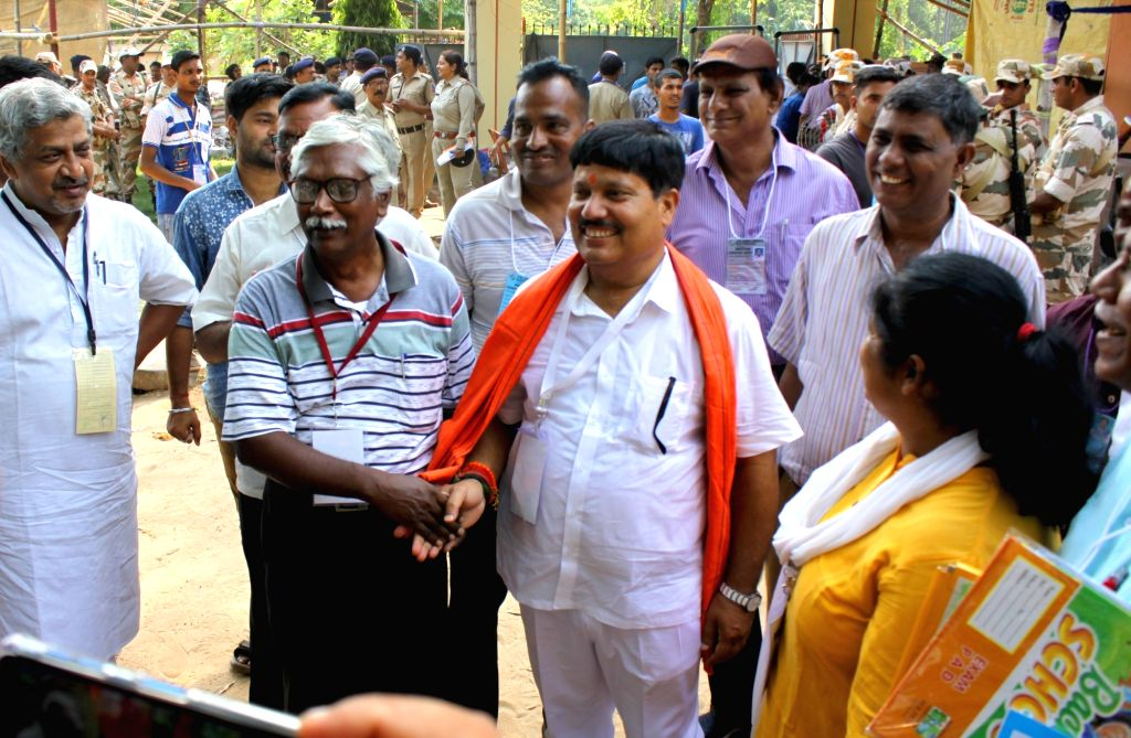 Bhatpara: BJP's Lok Sabha candidate from Barrackpore Arjun Singh and CPI-M candidate Gargi Chatterjee at a counting center at Barrackpore Rastraguru Surendranath College during the ongoing counting of votes cast for the 2019 Lok Sabha elections, in W - Barrackpore Arjun Singh, Gargi Chatterjee and Indrajit Roy
