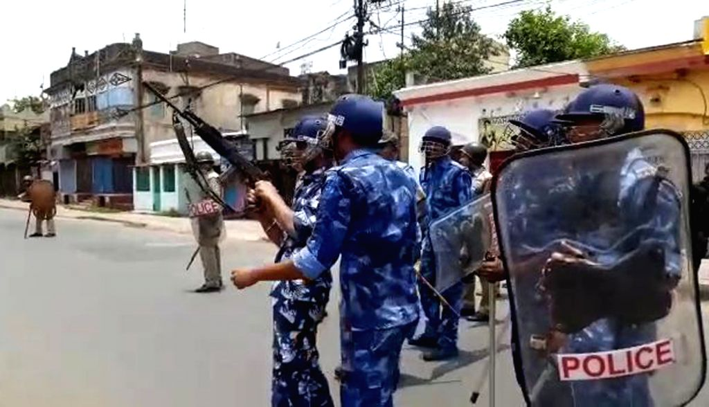 Bhatpara: Rapid Action Force personnel deployed after a man was killed as violence erupted at Bhatpara in West Bengal's North 24 Parganas district, on June 20, 2019. Prior to the inauguration of a new police station, violence broke out in the area as