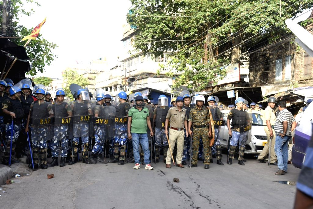 Bhatpara: Security beefed up in West Bengal's Bhatpara on June 21, 2019. On Friday morning, miscreants hurled a bomb in Kakinara amidst imposition of prohibitory orders and additional police reinforcement. (Photo: IANS)