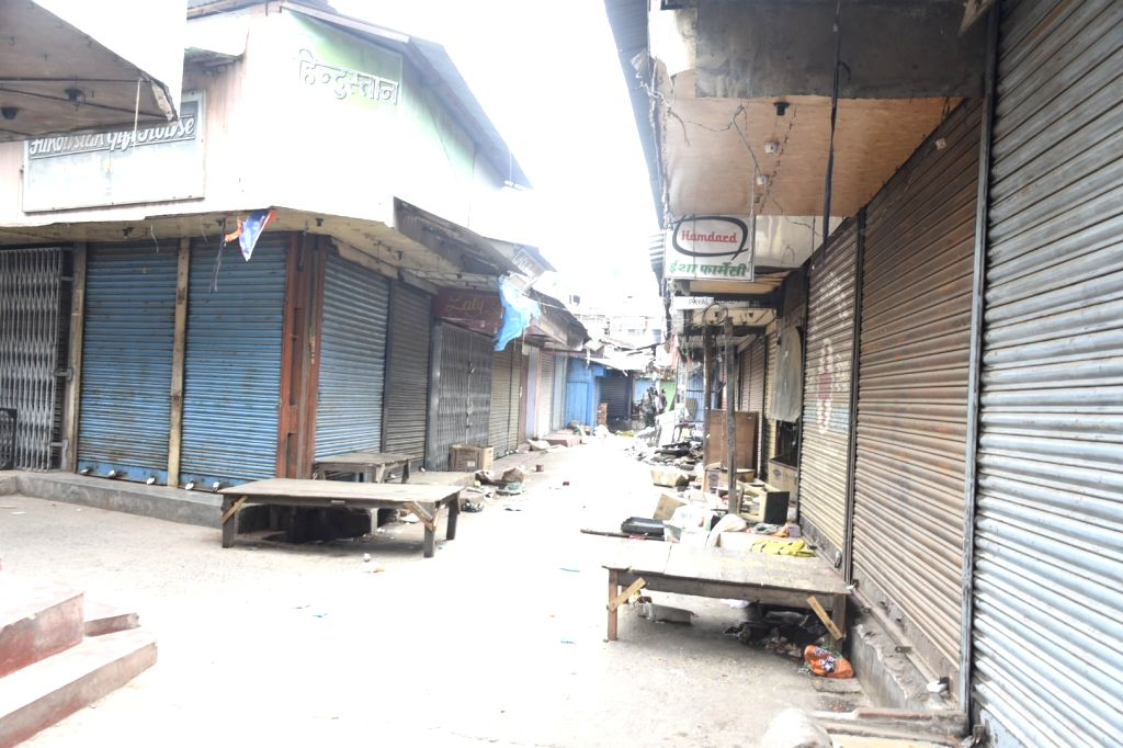 Bhatpara: Shops remain closed in West Bengal's Bhatpara on June 21, 2019. On Friday morning, miscreants hurled a bomb in Kakinara amidst imposition of prohibitory orders and additional police reinforcement. (Photo: IANS)