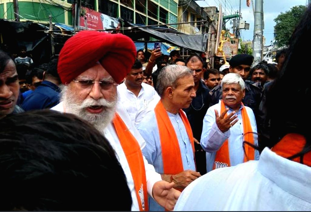 Bhatpara: The three-member BJP delegation led by party MPs S.S. Ahluwalia, Satya Pal Singh and Vishnu Dayal Ram during their visit to the violence-hit Bhatpara in West Bengal's North 24 Parganas district where two persons were shot dead during a clas - Satya Pal Singh