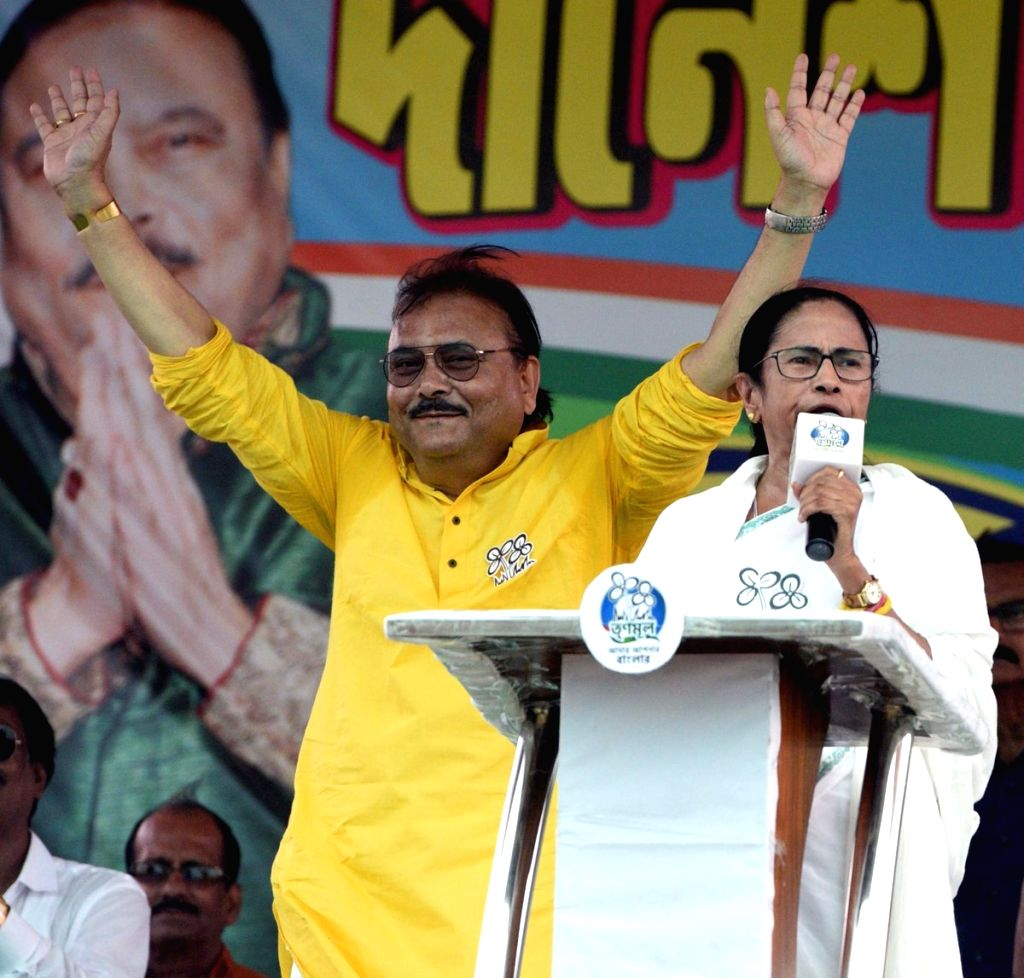Bhatpara: West Bengal Chief Minister Mamata Banerjee and Trinamool Congress leader Madan Mitra during a party rally in Bhatpara of West Bengal's North 24 Parganas district, on May 2, 2019. (Photo: IANS/AITC) - Mamata Banerjee