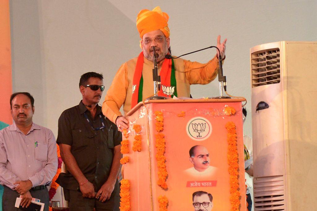 Bhilwara : BJP chief Amit Shah addresses during a party meeting, in Bhilwara, Rajasthan, on Sept 17, 2018. - Amit Shah