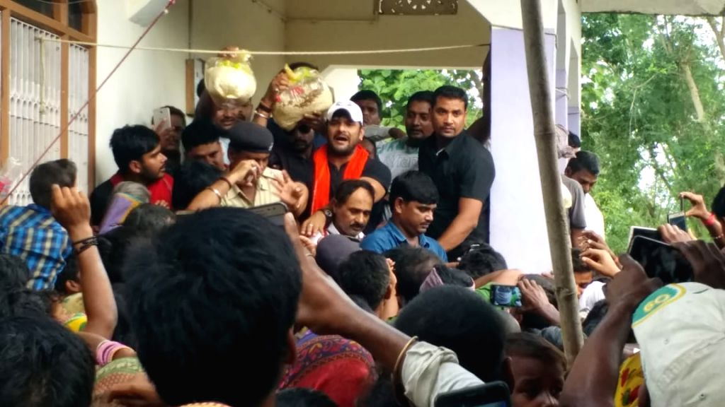 Bhojpuri actor Khesari Lal Yadav distributes relief material among flood victims in Bihar's Sitamarhi on July 27, 2019. - Khesari Lal Yadav