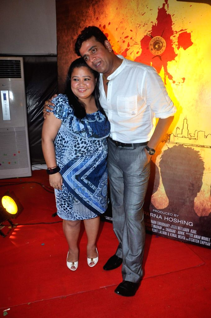 Bhojpuri and Bollywood film actor Ravi Kissen and TV Star Bharti Singh at the first look of the film Jeena Hai toh Thok Daal - Ravi Kissen and Bharti Singh