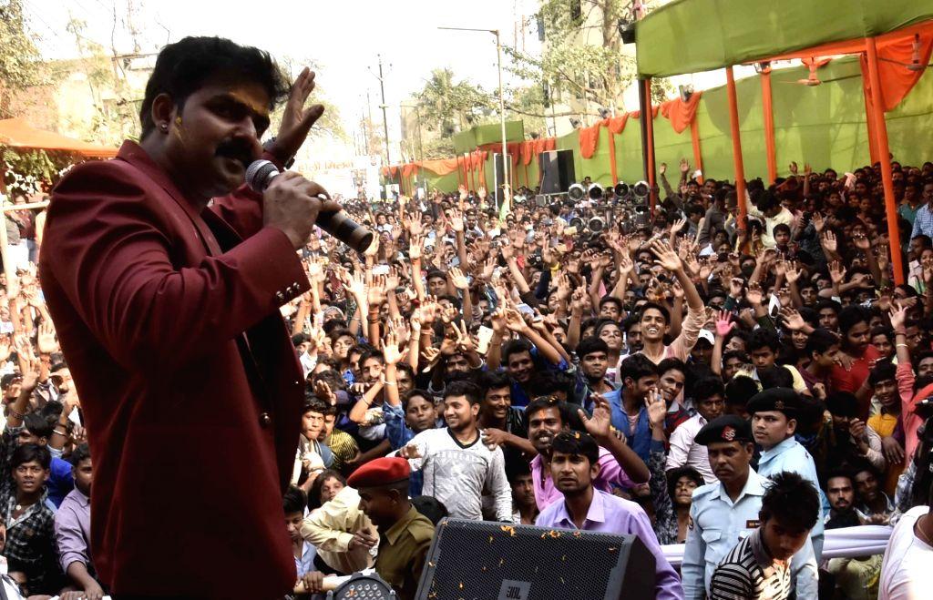 Bhojpuri singer Pawan Singh performs during a 'Holi Milan Samaroh' in Patna on March 10, 2017. - Pawan Singh