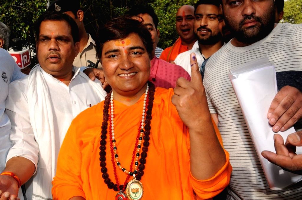 Bhopal: BJP's Lok Sabha candidate from Bhopal, Pragya Singh Thakur shows her forefinger marked with indelible ink after casting vote during the sixth phase of 2019 Lok Sabha elections, in Bhopal on May 12, 2019. (Photo: IANS) - Pragya Singh Thakur
