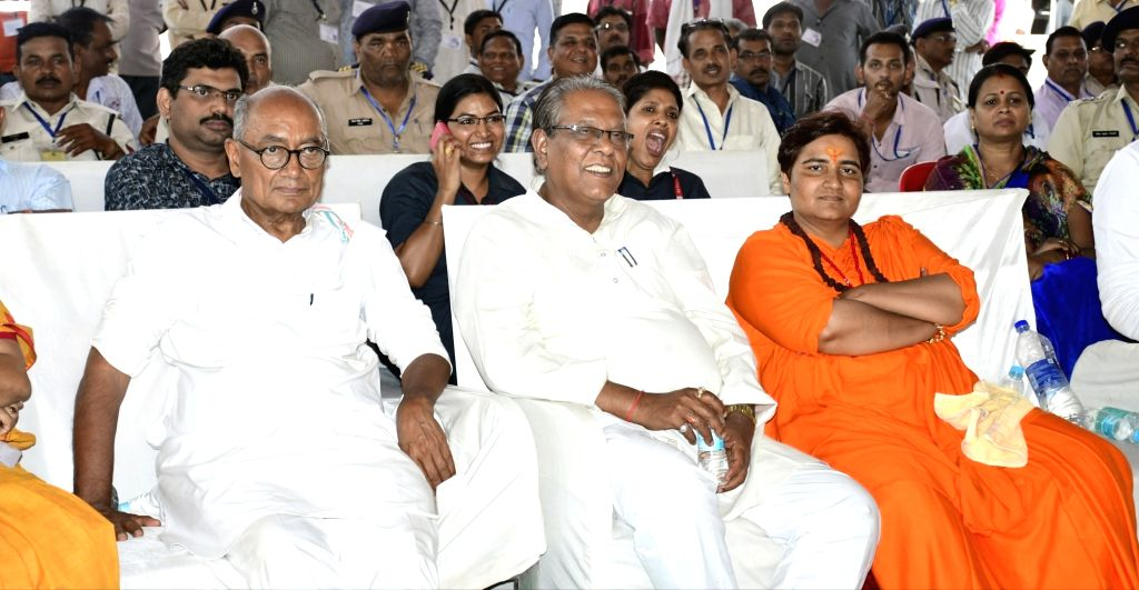 Bhopal: BJP's Lok Sabha candidate from Bhopal Sadhvi Pragya Singh Thakur who is leading by over 3.08 lakh votes in the 2019 Lok Sabha elections, and Congress candidate Digvijaya Singh at an election counting center during the counting of votes cast f - Digvijaya Singh