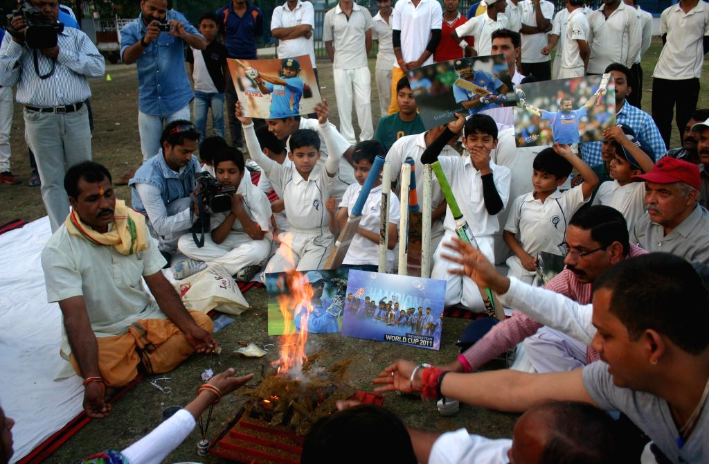 Budding cricketers and fans perform a ritual ahead of an ICC World Cup 2015 match of India Vs South Africa- scheduled to be held on 22nd Feb 2015 at Melbourne, Australia in Bhopal on Feb 21, ...