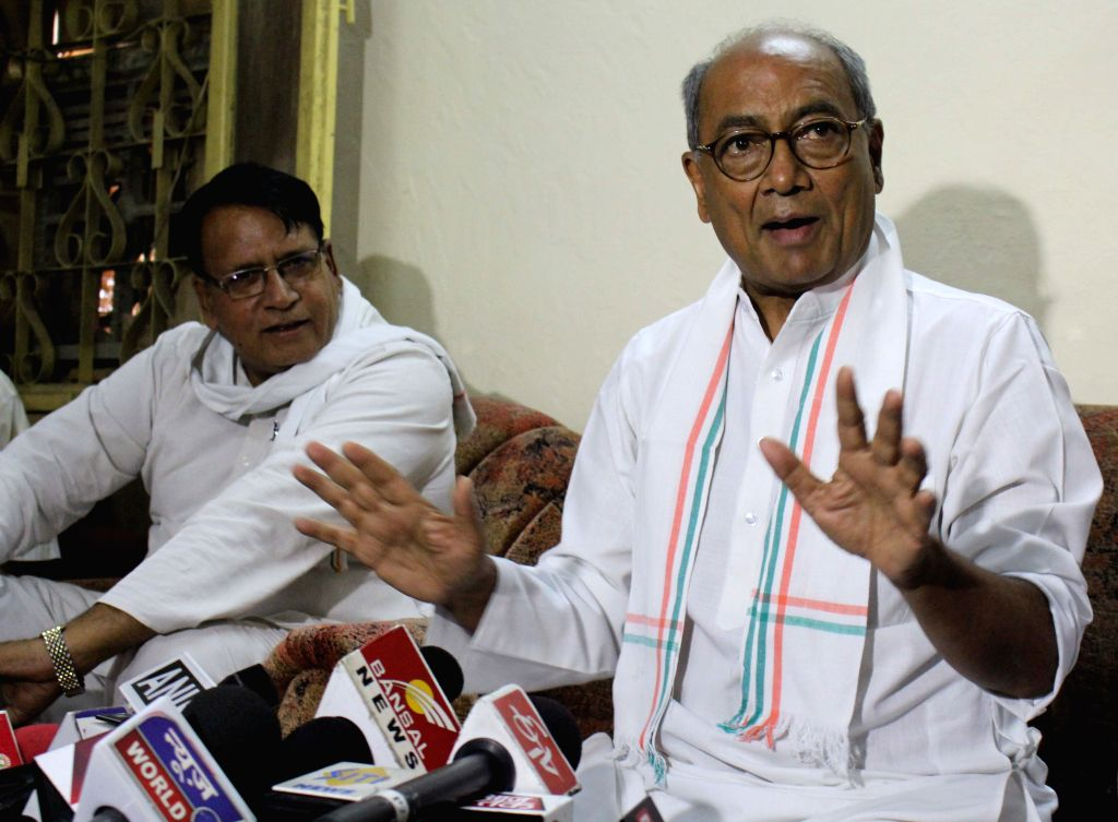 Congress General Secretary Digvijaya Singh addresses a press conference at his residence in Bhopal on April 23, 2015.
