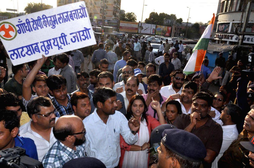 Congress workers stage a demonstration against Madhya Pradesh governor Ramnaresh Yadav in Bhopal, on Feb 24, 2015. - Ramnaresh Yadav