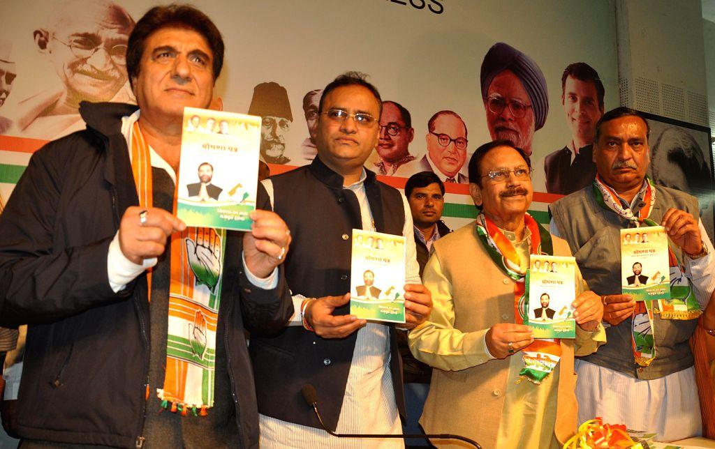 (L-R) Film actor and politician Raj Babbar, state congress president Arun Yadav, senior congress leader Suresh Pachouri, former Mayor Sunil Sood releasing party manifesto for civic body polls - Arun Yadav
