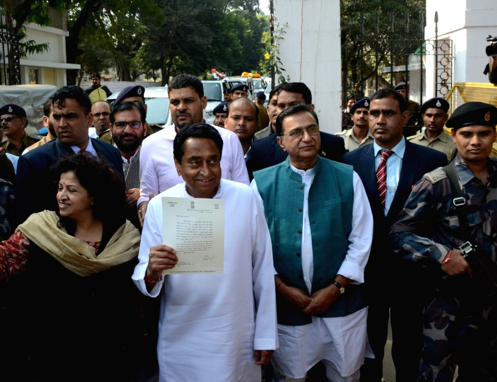 : Bhopal: Madhya Pradesh Chief Minister-designate Kamal Nath comes out after meeting Governor Anandiben Patel at Raj Bhawan in Bhopal on Dec 14, 2018. He was named the Chief Minister by Congress ...