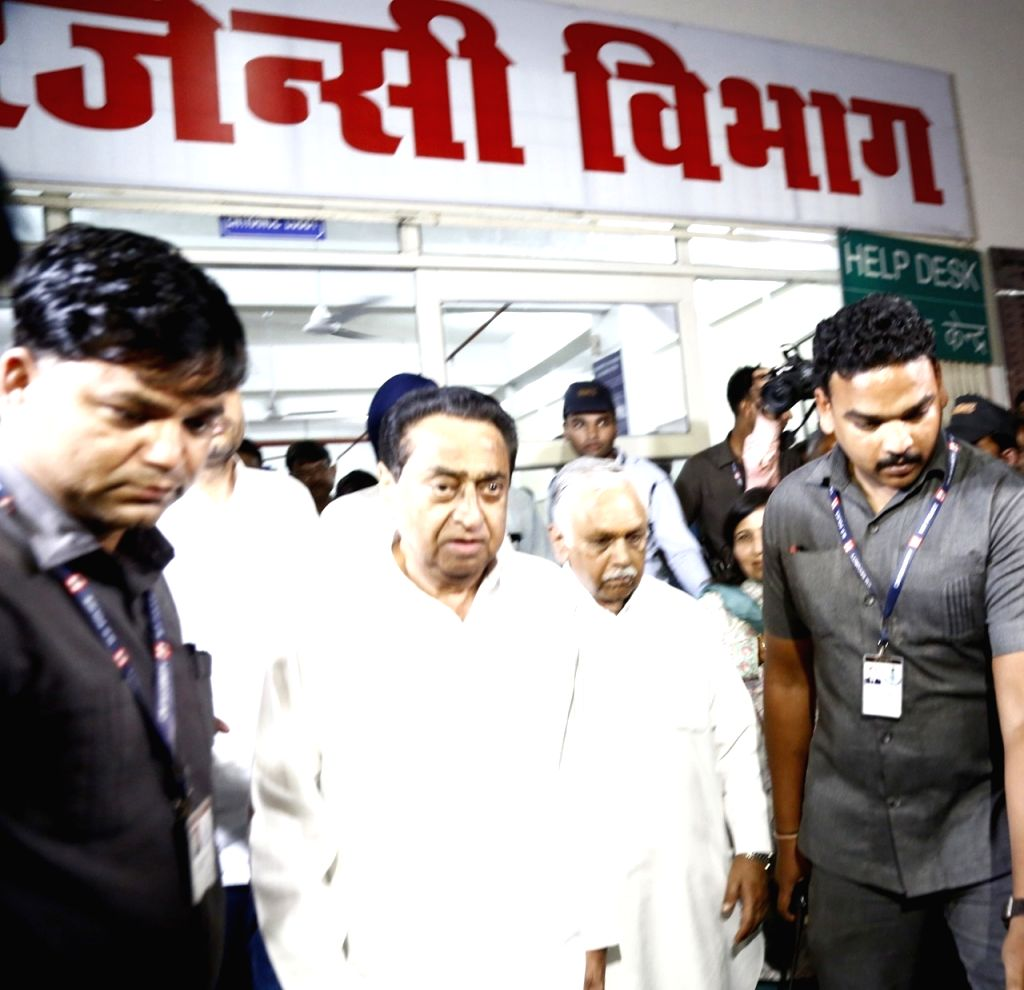 Bhopal: Madhya Pradesh Chief Minister Kamal Nath who was suffering from trigger finger, leaves after undergoing a successful operation at the Hamidia Hospital in Bhopal on June 22, 2019. Generally people belonging to the affluent class including poli - Kamal Nath and Shivraj Singh Chouhan