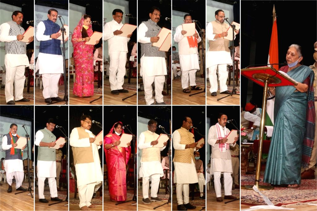 Bhopal: Madhya Pradesh Chief Minister Shivraj Singh Chouhan inducted 28 new ministers including 12 from Jyotiraditya Scindia's camp, in Bhopal on July 2, 2020. Of the 22 Congress MLAs who resigned from the Congress to join the BJP, 14 are now in the  - Shivraj Singh Chouhan and Anandiben Patel