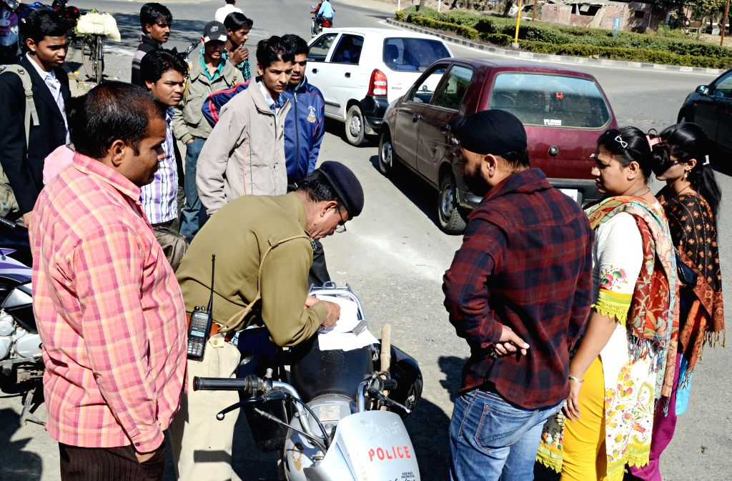 Bhopal, Madhya Pradesh, India, Monday, 24 Dec, 2012,  On the 34th day of zero tolerance drive, the traffic police on Sunday issued challans against several vehicles including those sporting red and yellow beacon lights. Traffic policemen deployed at