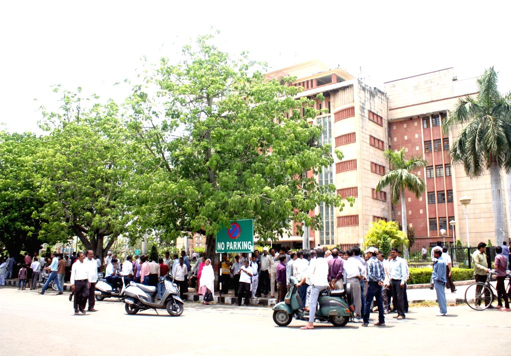 People rush out of Madhya Pradesh secretariat as tremors were felt in Bhopal on April 25, 2015. According to the India Meteorological Department, the depth of earthquake was 10 km and ...