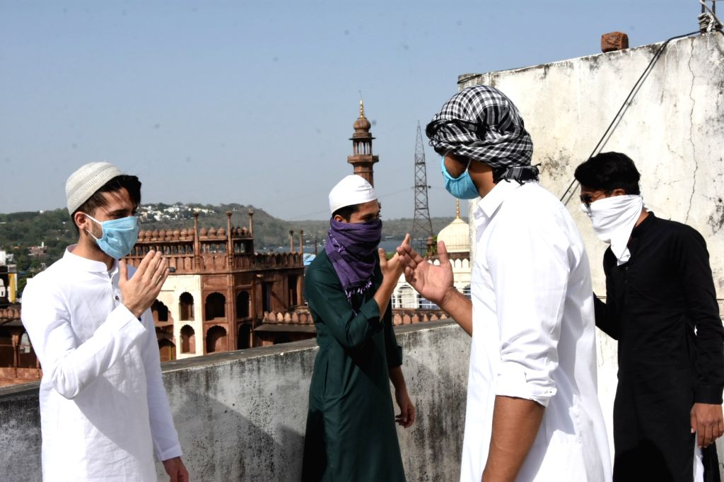 Bhopal: People wear masks and maintain social distance as they greet each other on the occasion of Eid-Ul-Fitr in Bhopal during the fourth phase of the nationwide lockdown imposed to mitigate the spread of coronavirus, on May 25, 2020. (Photo: IANS)