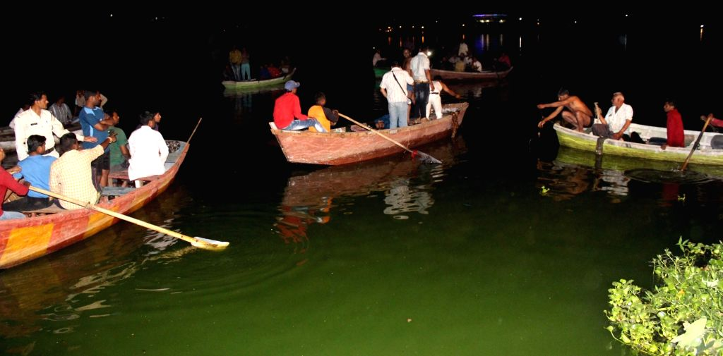 Bhopal: Rescue operation going on in a lake where four youth drowned late night as the boat capsized in Lower Lake in Bhopal on March 20, 2016. (Photo: IANS)