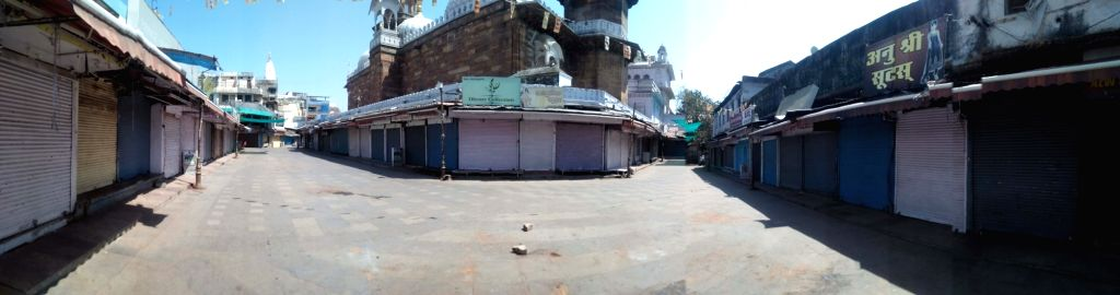 Bhopal: Shops remain closed during nationwide shutdown - Janata Curfew - called by Prime Minister Narendra Modi as a measure to contain the spread of COVID-19, in Bhopal on March 22, 2020. (Photo: IANS) - Narendra Modi