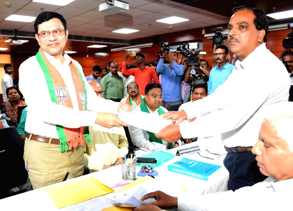 Bhubaneswar: BJD-backed BJP candidate Ashwini Baishnab submits his nomination papers before the Returning Officer (RO) at the State Assembly for the Rajya Sabha by-polls scheduled to take place in Odisha on July 5, in Bhubaneswar on June 24, 2019. Tw