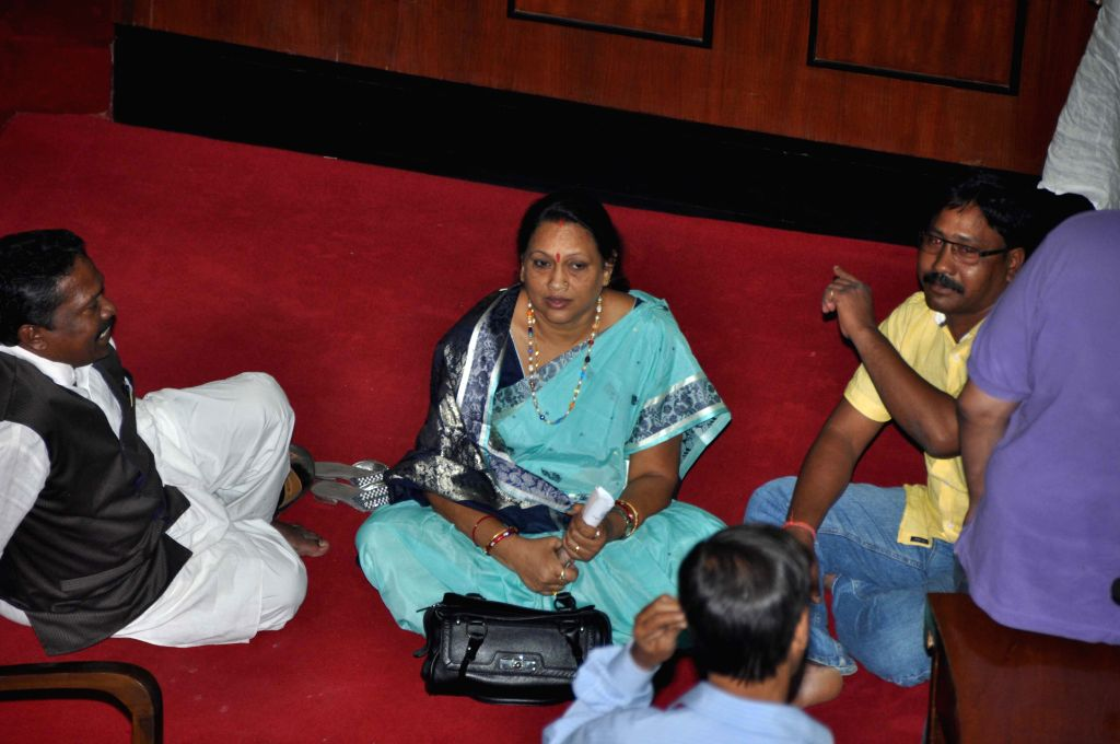 BJP MLA Radharani Panda sit on a dharna in front of speaker in the assembly session, protest against rulling BJD agriculture minister Pradeep Maharathy offensive UN parliamentary ... - Pradeep Maharathy