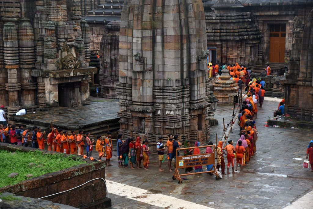 Bhubaneswar: Devotees queue up to offer prayers to Lord Shiva at Lingaraj Temple on the occasion of 'Sawan Shivratri', in Bhubaneswar on July 29, 2019. (Photo: IANS)