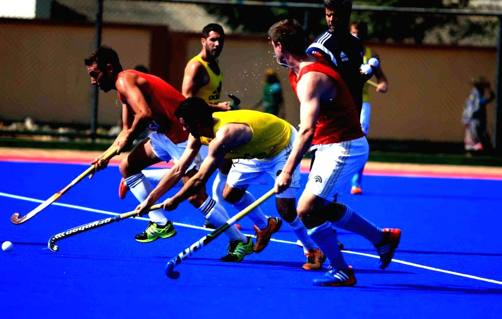 Members of Argentine Hockey team during a practice session at Kalinga Stadium in Bhubaneswar, on Dec 1, 2014. (Photo : IANS)
