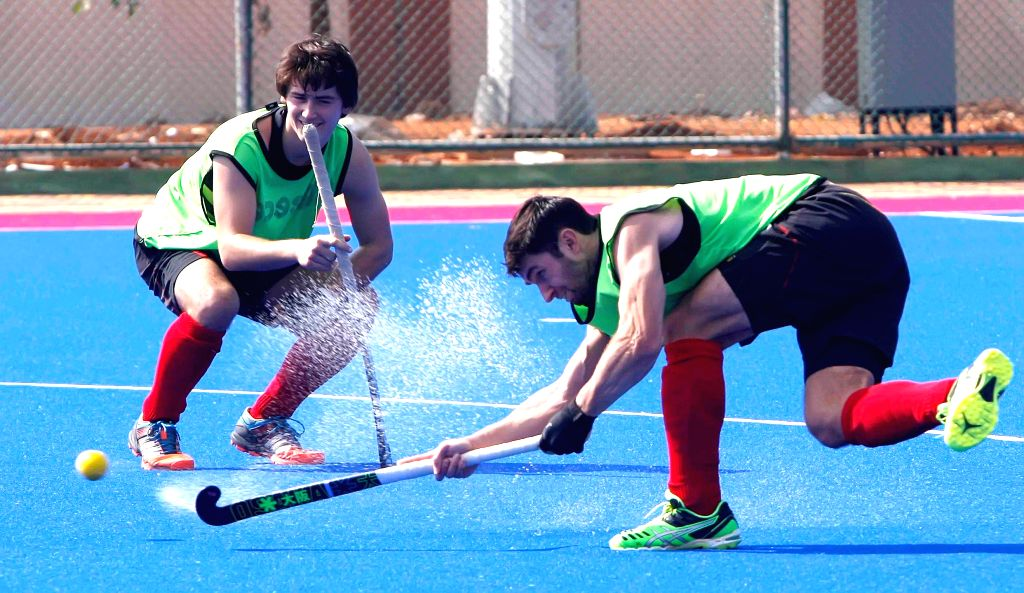 Members of Belgian Hockey team during a practice session at Kalinga Stadium in Bhubaneswar, on Dec 1, 2014. (Photo : IANS)
