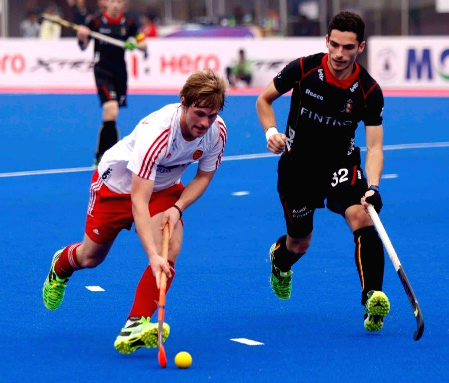 Players in action during a Hero Men`s Champions Trophy 2014 match between England and Belgium at Kalinga Stadium in Bhubaneswar on Dec 9, 2014. Match Draw. Score: 1-1