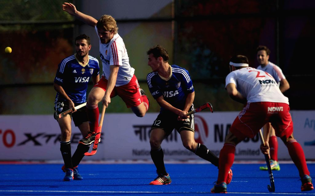 Players in action during a HHCT - 2014 (Hero Hockey Men`s Champions Trophy 2014) match between England and Argentina at Kalinga Stadium in Bhubaneswar on Dec 13, 2014. England won.