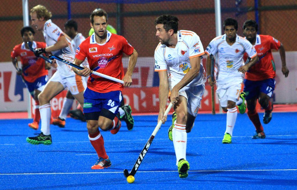 Players in action during a Hockey India League match between Kalinga Lancers and Dabang Mumbai in Bhubaneswar, on Feb 11, 2015.