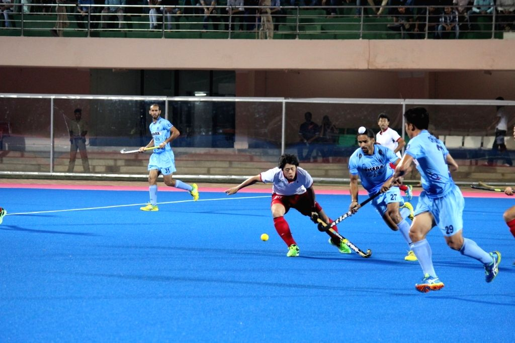 Players in action during a Hockey Test Series match between India and Japan at Kalinga Stadium, Bhubaneswar on May 3, 2015.