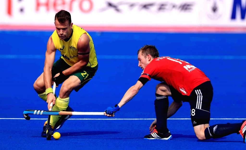 Players in action during a Pool A match between England and Australia of Hero Men`s Champions Trophy 2014 at Kalinga Stadium in Bhubaneswar on Dec 6, 2014. England won 3-1.