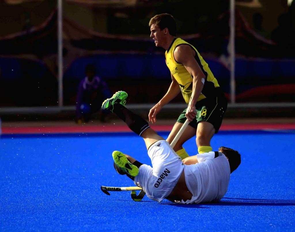 Players in action during a practice match of Hero Men's Champions Trophy 2014 between Australia and Argentina at Kalinga Stadium in Bhubaneswar on Dec 4, 2014. Australia won.