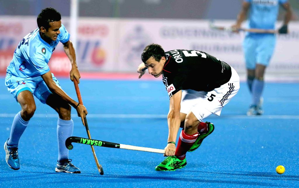 Players in action during Hero Men's Champions Trophy 2014 match between India and Germany at Kalinga Stadium in Bhubaneswar on Dec 6, 2014.