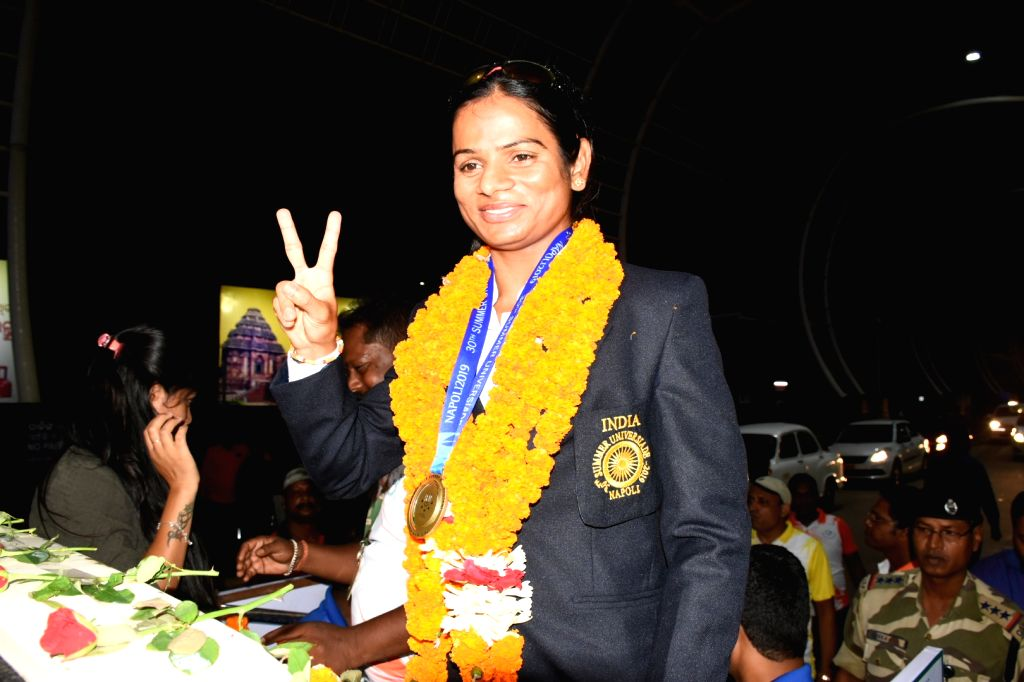 Bhubaneswar: Sprinter Dutee Chand, who recently became the first Indian athlete to clinch a gold medal in the women's 100-metre sprint category at the 30th Summer University Games in Italy; arrives in Bhubaneswar on July 15, 2019. (Photo: IANS)
