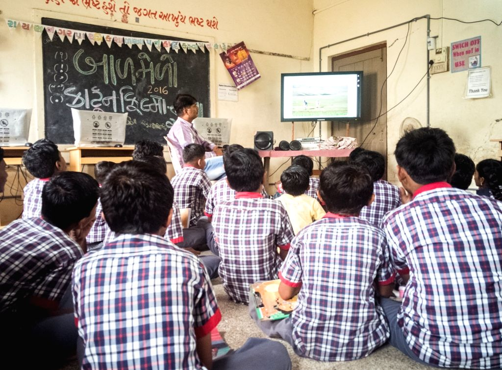 Bhuj (Gujarat): Children learning through the e-learning software in their classroom