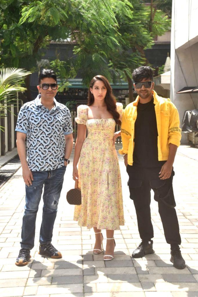 Bhushan Kumar, Nora Fatehi & Guru Randhawa at Tseries office in Mumbai's Andheri on October 18, 2020. - Bhushan Kumar