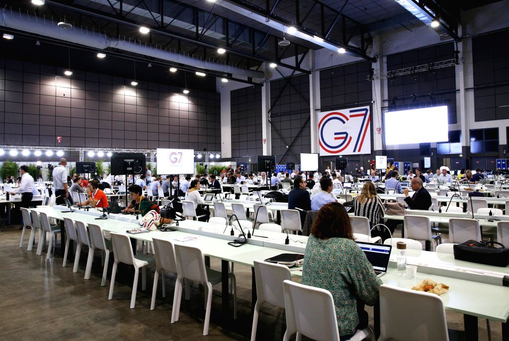 BIARRITZ, Aug. 25, 2019 - Journalists work at the G7 summit press center in Biarritz, France, Aug. 25, 2019. ers from the world's seven most industrialized countries started the divided group's ...