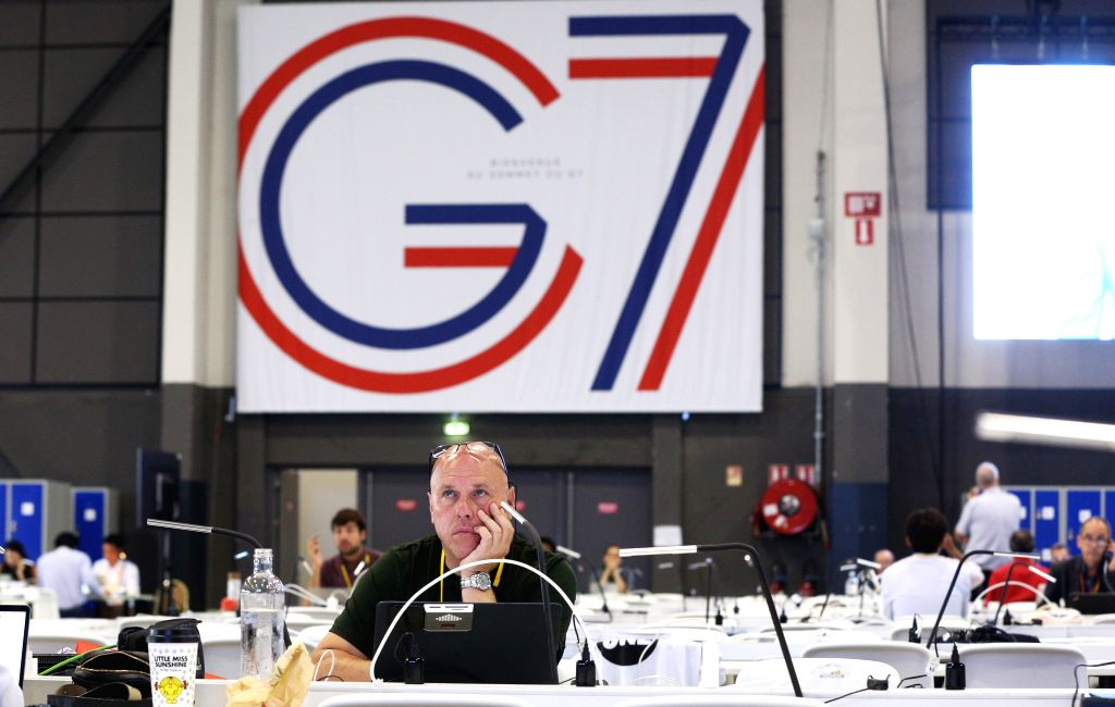 BIARRITZ, Aug. 25, 2019 (Xinhua) -- Journalists work at the G7 summit press center in Biarritz, France, Aug. 25, 2019. Leaders from the world's seven most industrialized countries started the divided group's 45th summit, clouded by a pile of tough is