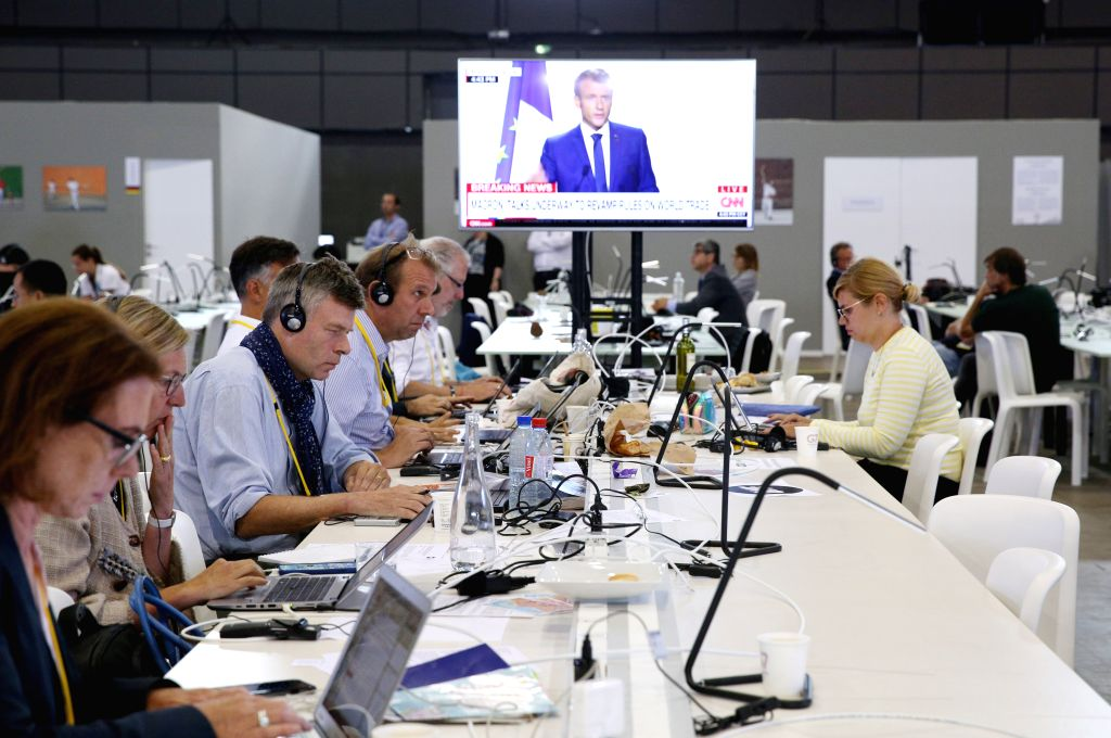 BIARRITZ, Aug. 26, 2019 - Journalists work at the G7 summit press center in Biarritz, France, Aug. 26, 2019. The summit of the G7 heads of state was held on Aug. 24 to 26 in Biarritz.
