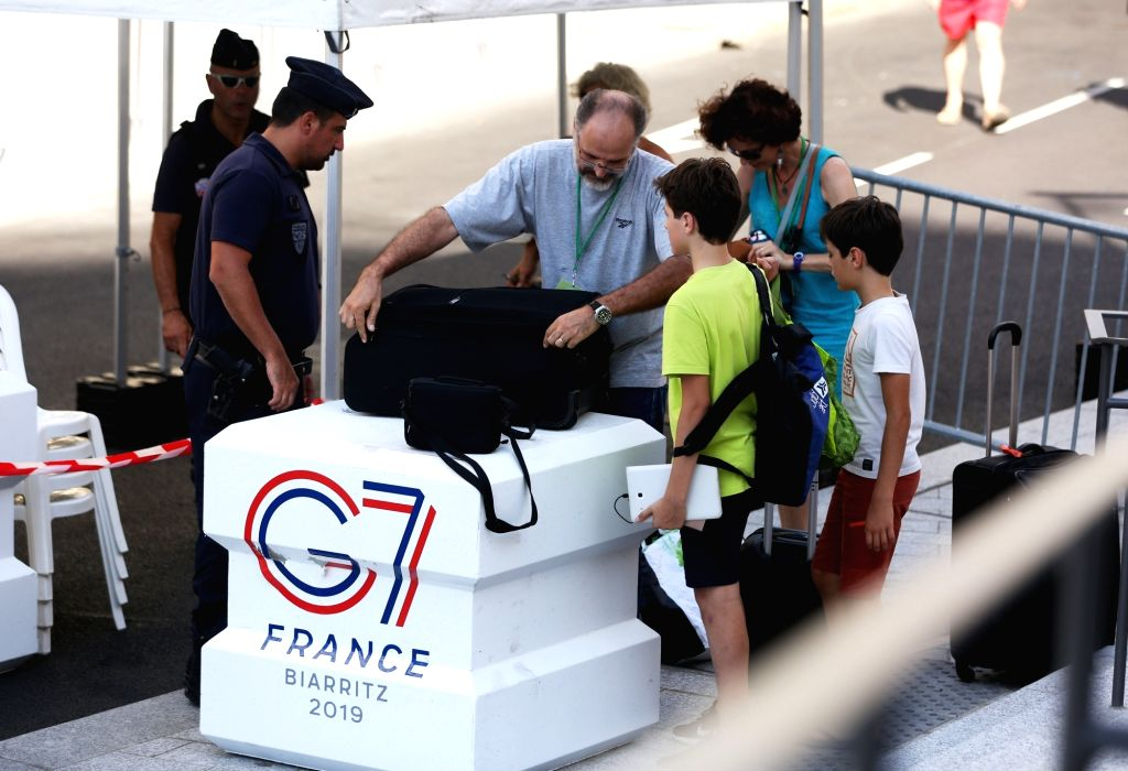 BIARRITZ (FRANCE), Aug. 24, 2019 Security personnel check bags in Biarritz, southwestern France, on Aug. 23, 2019.