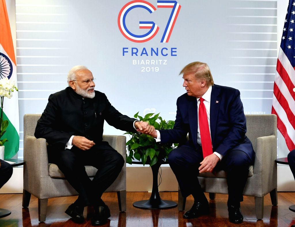 Biarritz: Prime Minister Narendra Modi meets US President Donald Trump on the sidelines of the G7 Summit in Biarritz, France on Aug 26, 2019. (Photo: IANS/PMO) - Narendra Modi