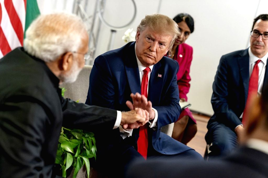 Biarritz: Prime Minister Narendra Modi meets US President Donald Trump on the sidelines of the G7 Summit in Biarritz, France on Aug 26, 2019. (Photo: IANS/MEA) - Narendra Modi