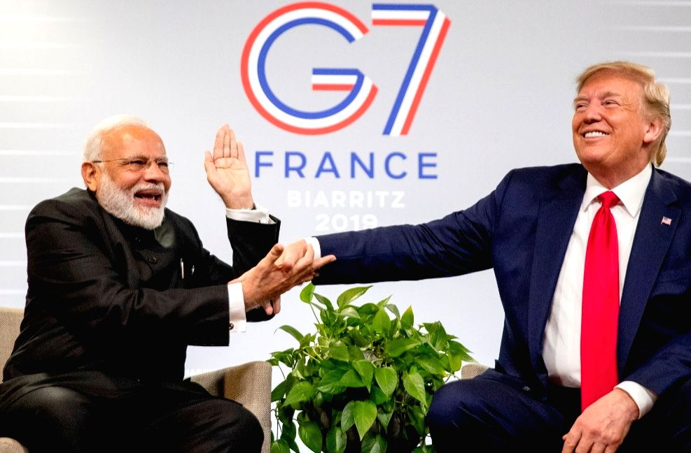 Biarritz: Prime Minister Narendra Modi meets US President Donald Trump on the sidelines of the G7 Summit in Biarritz, France on Aug 26, 2019. (Photo: IANS) - Narendra Modi