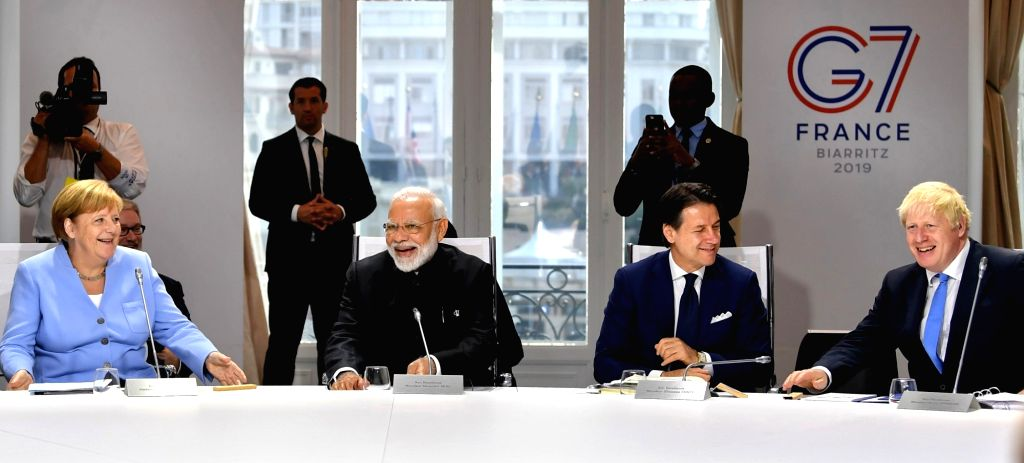 Biarritz: Prime Minister Narendra Modi with German Chancellor Angela Merkel, Italian Prime Minister Giuseppe Conte and British Prime Minister Boris Johnson during the session on 'Biodiversity, Oceans, Climate' at the G7 Summit in Biarritz, France on  - Narendra Modi